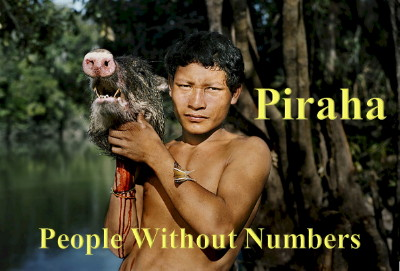 Image of Man from the Piraha Tribe in the Amazon. He is carrying a pig's head.