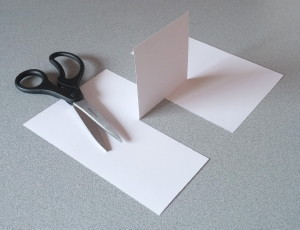 Thumbnail Image of a Cut Sheet of Paper Together With a Pair of Scissors. The Paper is Cut in a Surprising Way.