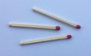 Photograph of Three Unused Match Sticks Lying Side by Side