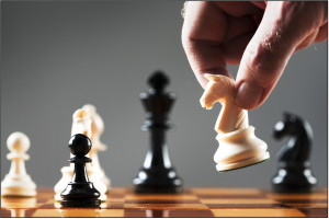 Hand Moving a Chess Piece During a Game