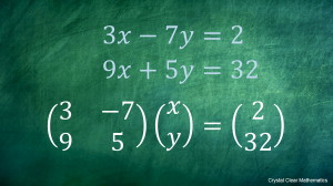 Two simultaneous Linear Equations on a Chalkboard with the Equivalent Statement Written in Matrix Notation Underneath