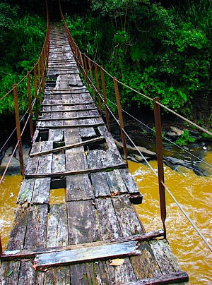 Kotmale Footbridge in Sri Lanka. It is a rickety wooden bridge.
