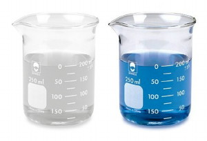 Two beakers with different coloured liquids in them